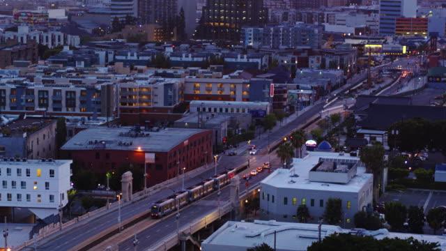stockvideo's en b-roll-footage met gold line train crossing first street bridge in los angeles - drone shot - metro passagierstrein