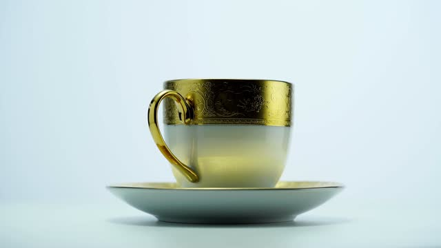 gold liner tea cup and saucer - saucer stock videos & royalty-free footage