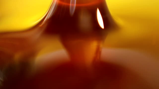 Gold Liquid Pouring, Extreme Close-Up