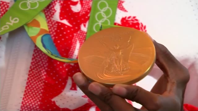 12 gold medals won by londoners farah holding olympic gold medals mo farah interview sot - olympic medal stock videos & royalty-free footage