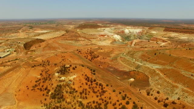 gold mine in the australian outback. aerial view - gold mine stock videos and b-roll footage