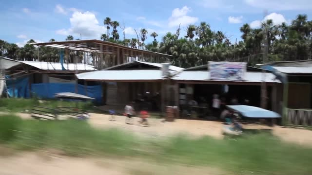 cs gold mining village view from moving car the region of madre de dios in southeastern peru has been devastated by illegal gold mining it has a... - resourceful stock videos & royalty-free footage
