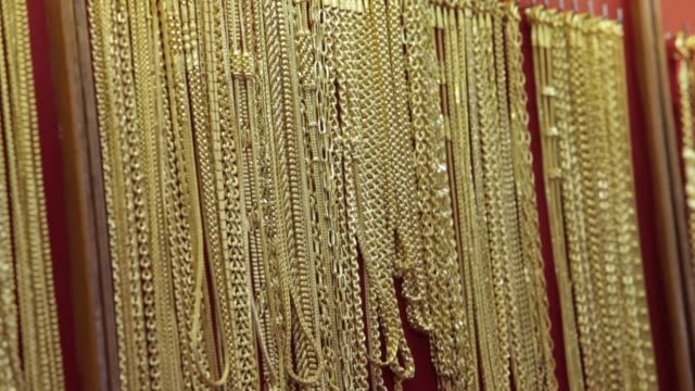 Gold necklaces hang on display inside the Hua Seng Heng Gold Shop in the Chinatown area of Bangkok Gold sales in Bangkok on April 18 2013 in Bangkok...