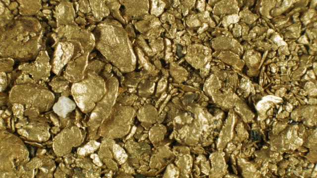 gold nuggets panned from a river in the ecuadorian andes - metal ore stock videos & royalty-free footage