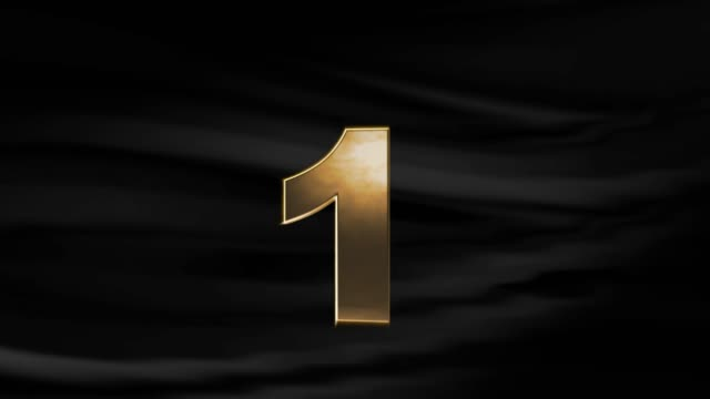 gold number one sign is turning with waving black cloth background in 4k resolution - number 1 stock videos & royalty-free footage