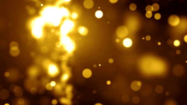 gold particles background video loop (full hd) - glowing stock videos & royalty-free footage
