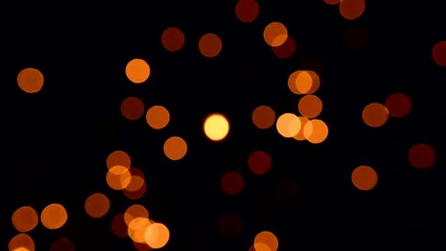 goldene partikel funkelnden loop - unscharf gestellt stock-videos und b-roll-filmmaterial