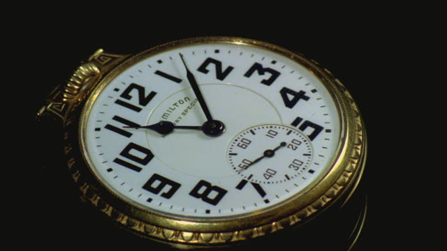 ms t/l gold pocket watch rotating with hour hand advancing / santa barbara, california, united states - 懐中時計点の映像素材/bロール