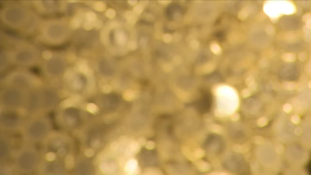 gold pound coins falling into a pile - royal mint stock videos & royalty-free footage