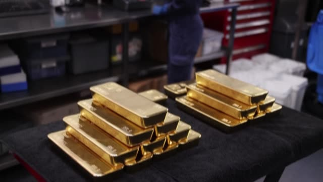 gold prices hit $2,000 an ounce for the first time earlier this week, the latest surge in a commodity seen as a refuge during economic uncertainty - uncertainty stock videos & royalty-free footage