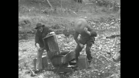 gold prospectors digging and panning by shallow stream, man on horseback leading burros / men prospecting / closer shot man shoveling dirt into... - panning stock videos & royalty-free footage