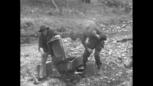 gold prospectors digging and panning by shallow stream man on horseback leading burros / men prospecting / closer shot man shoveling dirt into... - panning stock videos & royalty-free footage