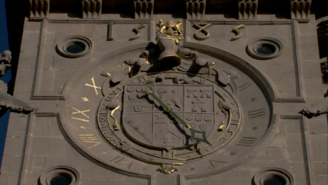 gold roman numerals decorate the clock on the facade of burghley house in northamptonshire, england. available in hd. - roman numeral stock videos & royalty-free footage
