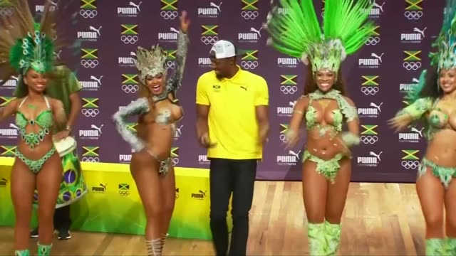 'gold rush' photography exhibition of olympic stars **ellis live studio interview overlaid sot** usain bolt dancing with brazilian women dressed in... - bolt stock videos & royalty-free footage
