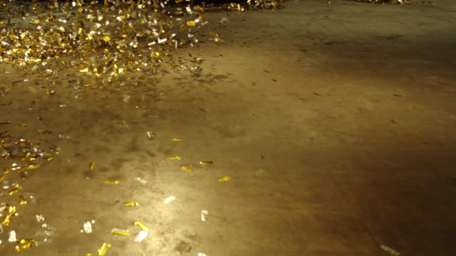 vídeos de stock, filmes e b-roll de slo mo gold sequin blown across floor - 2016