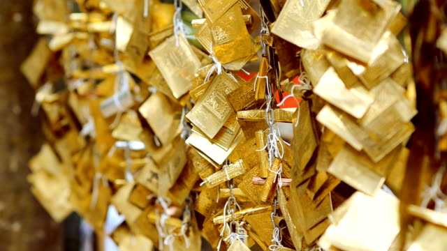 gold sheet string of buddhism faith - string stock videos and b-roll footage