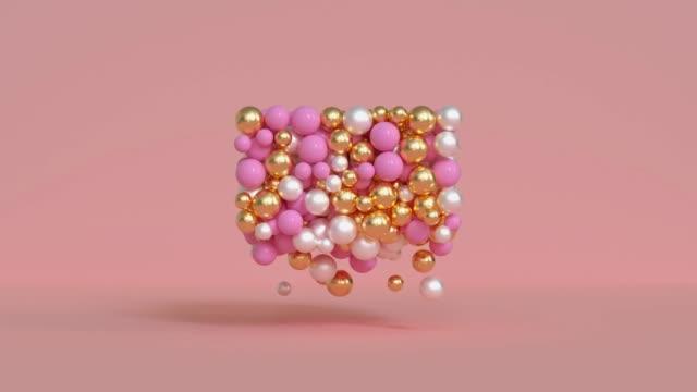 金銀金属球粒子ピンクシーン3dレンダリングモーション - ball点の映像素材/bロール