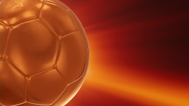 gold soccer ball  loopable - 4k - championship stock videos & royalty-free footage