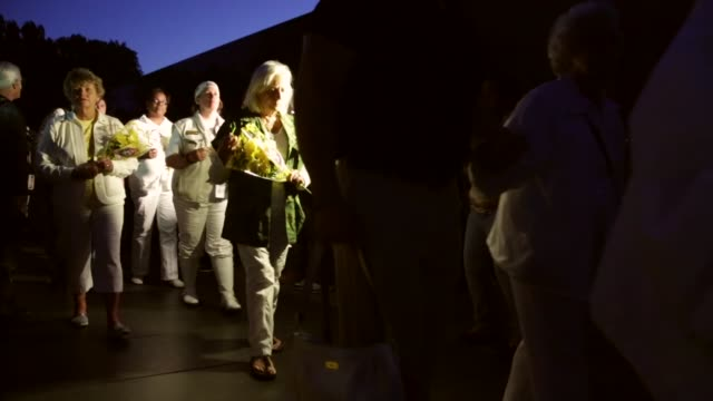 stockvideo's en b-roll-footage met ts gold star mothers and gold star wives participate in a candlelight vigil at the vietnam veterans memorial prior to the memorial day weekend may 23... - vietnam veterans memorial