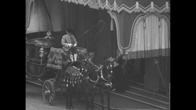 gold state coach bearing king george vi and queen elizabeth makes turn as it proceeds toward westminster abbey huge crowd stands in foreground / big... - coronation stock videos and b-roll footage