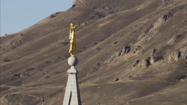 gold statue of moroni atop the salt lake city temple. - mormonism stock videos & royalty-free footage