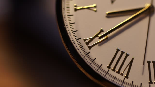 Gold watch second hand close up