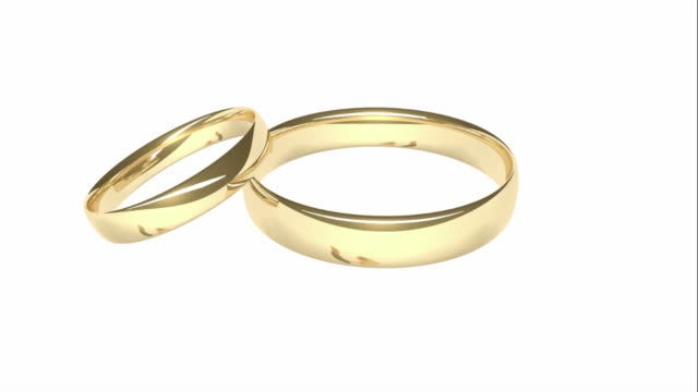 Gold Wedding Rings - Reflected Bride and Groom