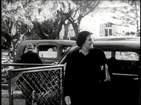vídeos de stock, filmes e b-roll de golda meir walks from a car to a meeting with david ben gurion - 1948