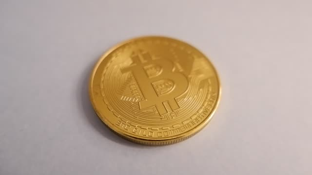 golden bitcoin physical real money coin - information medium stock videos & royalty-free footage
