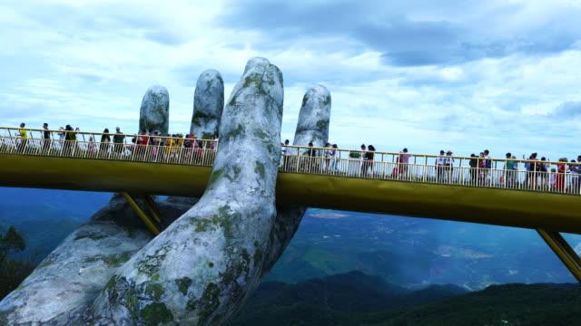 vídeos de stock, filmes e b-roll de golden bridge in ba na hills, vietnam, asia - part of