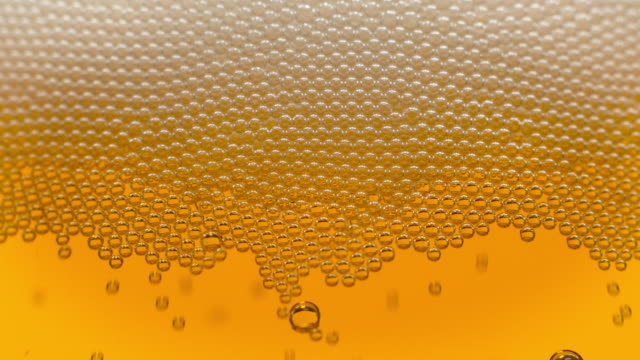 golden bubbles in beer - beer alcohol stock videos & royalty-free footage