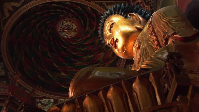la, zi, cu golden buddha figure - male likeness stock videos & royalty-free footage