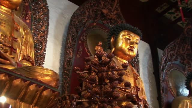la, zi, cu golden buddha figures - male likeness stock videos & royalty-free footage