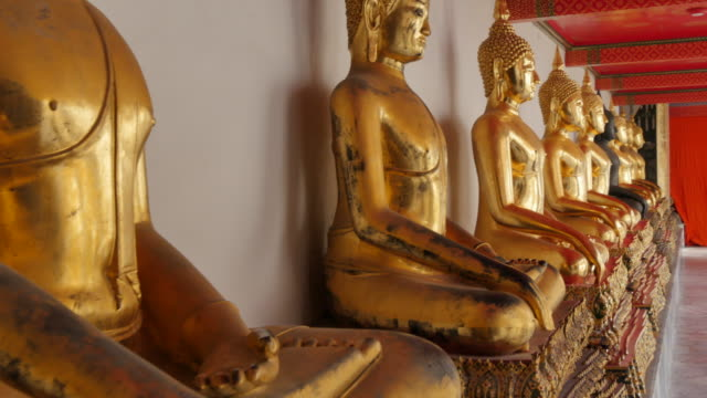 golden buddhas in wat pho (temple of the reclining buddha), bangkok, thailand, southeast asia, asia - male likeness stock videos & royalty-free footage