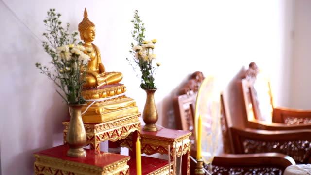Golden Buddhist Buddha and religious symbols.