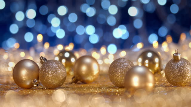 golden christmas time - decorations lights bokeh defocused blue gold - tre oggetti video stock e b–roll