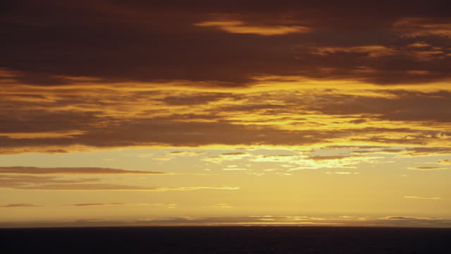 golden clouds over the sea at sunset - sea passage stock videos and b-roll footage