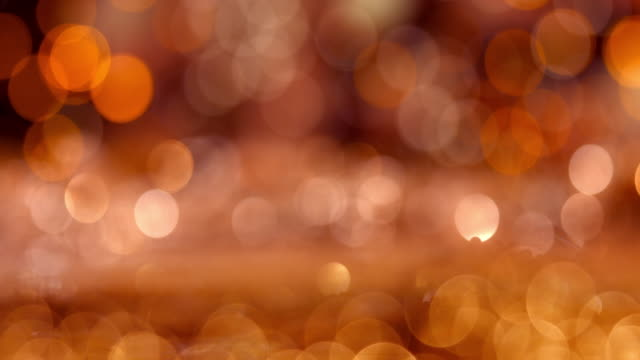 golden color abstract glitter texture background for holidays - orange colour stock videos & royalty-free footage