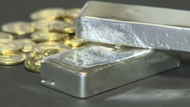 golden commemorative coins and silver ingots - metal ore stock videos & royalty-free footage