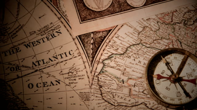 golden compass on antique map - drawing compass stock videos & royalty-free footage