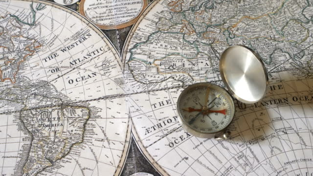 golden compass on antique map - antique stock videos & royalty-free footage
