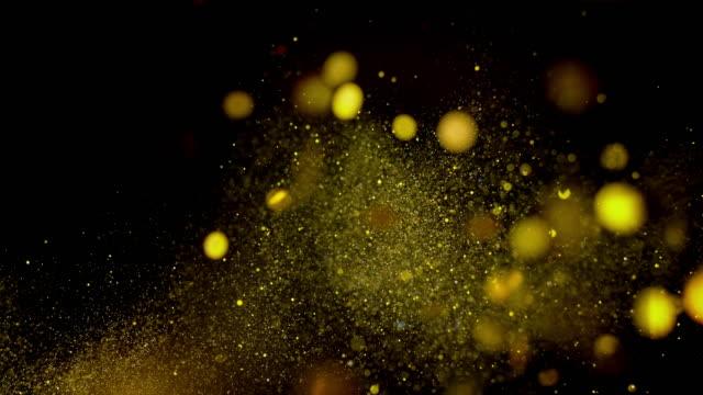 slo mo ld goldenkonfetti und glitzer in der luft - konfetti stock-videos und b-roll-filmmaterial