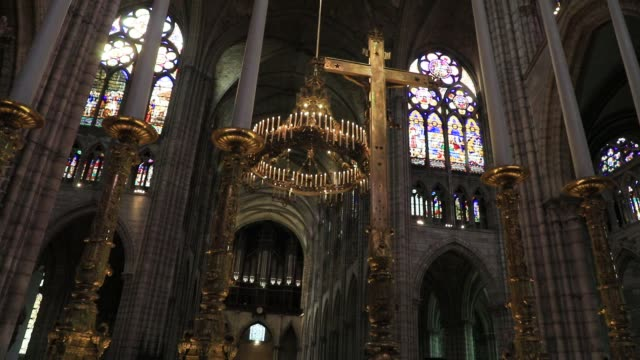 golden cross and stained-glass windows at the basilica of saint-denis in the outskirts of paris on july 5, 2020 in saint denis, france. the church... - basilica video stock e b–roll