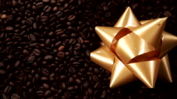 Golden decorative bow on coffee beans.