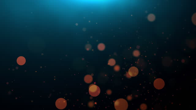 golden defocused lights and particles over dark background - 4k loop - seamless pattern stock videos & royalty-free footage