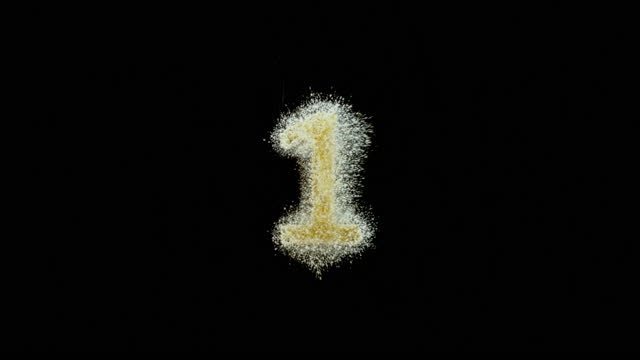 "slo mo ld golden dust falling onto a black surface forming the number ""1"" - number 1 stock videos & royalty-free footage"