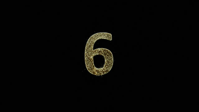 "slo mo ld golden dust falling onto a black surface forming the number ""6"" - number 6 stock videos & royalty-free footage"