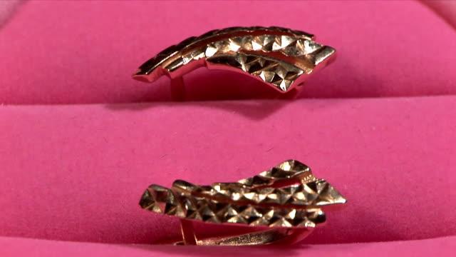 golden earrings rotate - earring stock videos & royalty-free footage