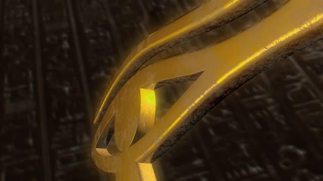 cgi golden eye of horus - hieroglyph stock videos & royalty-free footage