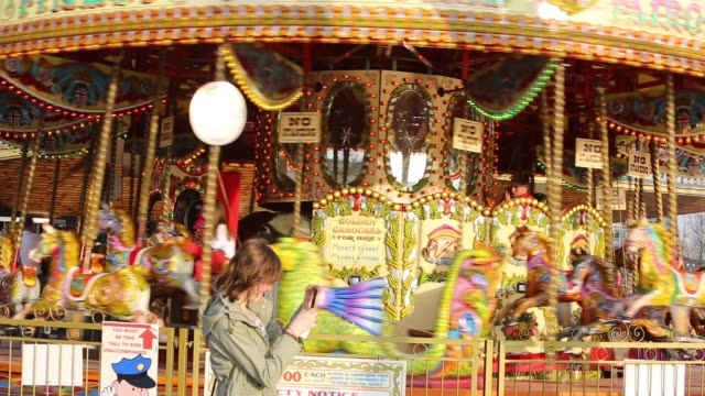 golden gallopers fairground ride on the embankment in london. - embankment stock videos & royalty-free footage
